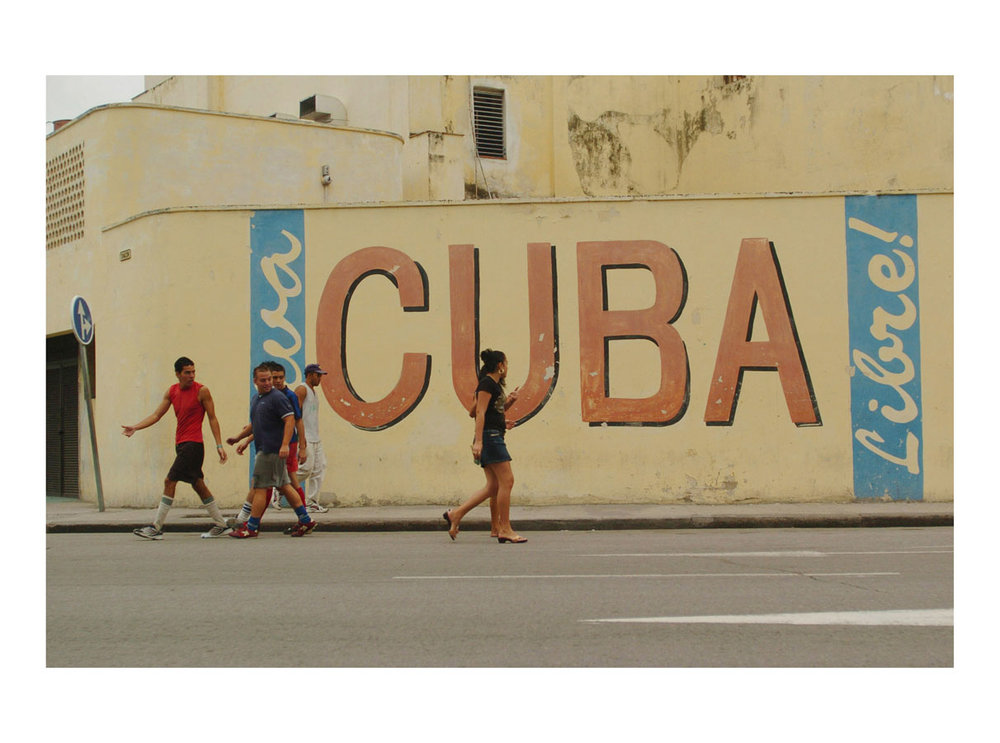 Viva Cuba Libre!  (Havana, Cuba, 2006) by Johnny Green (53 x 73cm)  Price: £450   Size: 20.9 H x 28.7 W x 1.7 in   This is the 1st of 12 Limited Edition C-type Lambda prints, encased in a beautiful, black wooden frame. The matt photograph has an elegant off white mount which is signed and numbered by the artist.