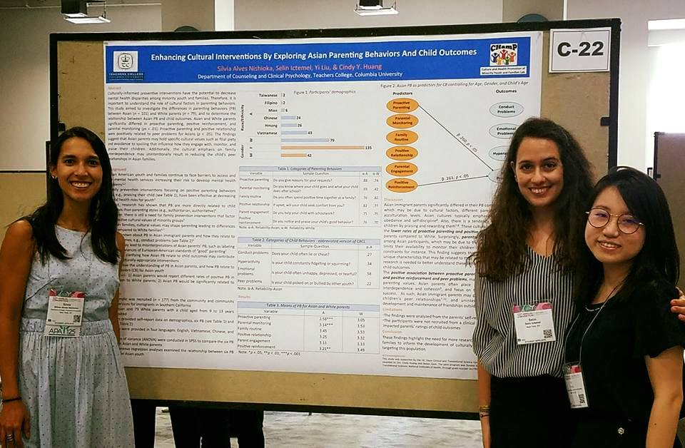 "Silvia, Selin, and Yi presenting their poster ""Enhancing Cultural Interventions by Exploring Asian Parenting Behaviors and Child Outcomes"""