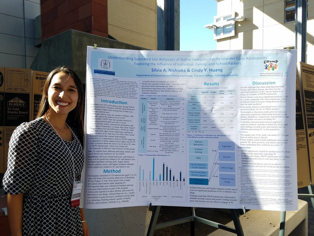 "Silvia presenting her poster ""Understanding Substance Use Behaviors of Hawaiian and Pacific Islander Early Adolescents: Exploring the Influence of Family, School, and Individual Factors"""