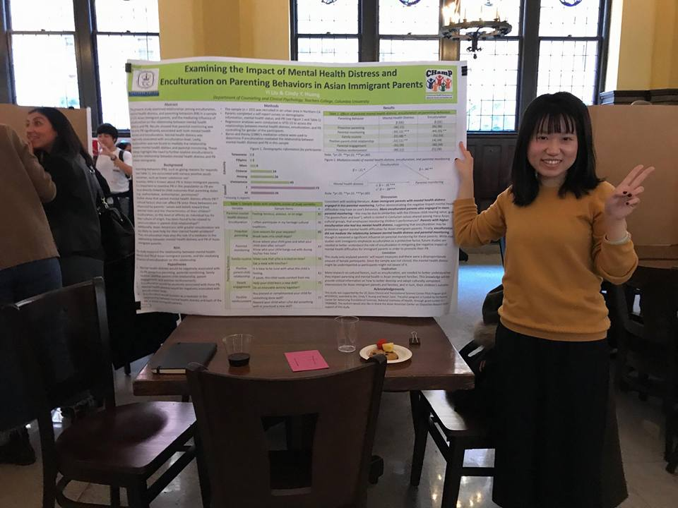 Yi presenting her poster at the conference.