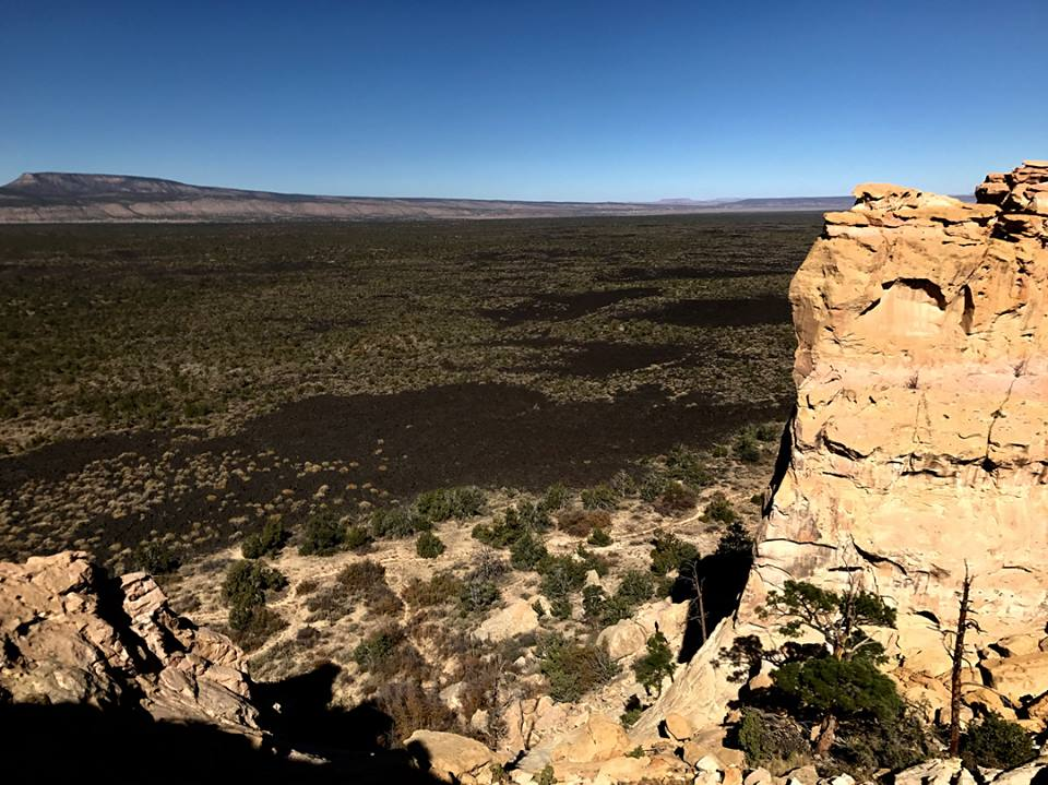 Sandstone cliffs on the eastern side of El malpais, and the valley filled with lava below