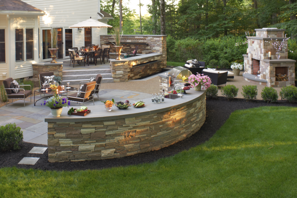 Expert landscape design with an outdoor kitchen inWaltham, MA