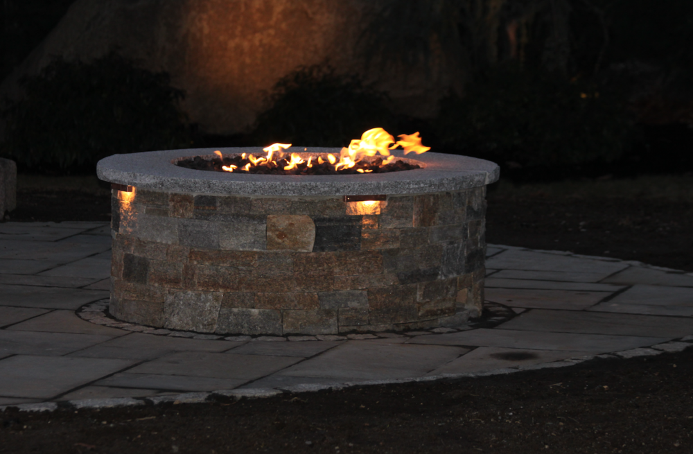 Best landscape design with circular fire pitinMilford, NH