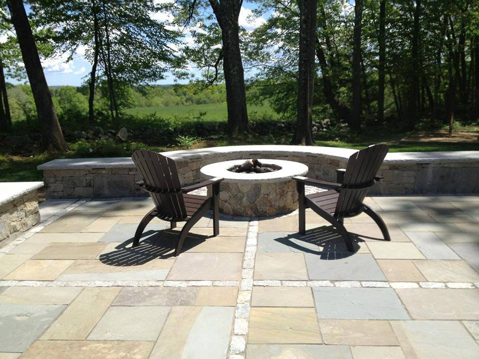 Top landscape design with a fire pit inNewton, MA