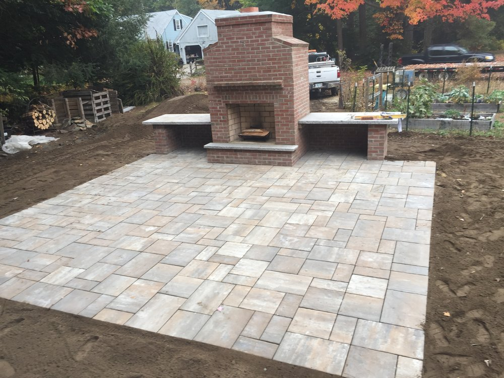 Professional landscape design with an outdoor fireplace inLexington, MA