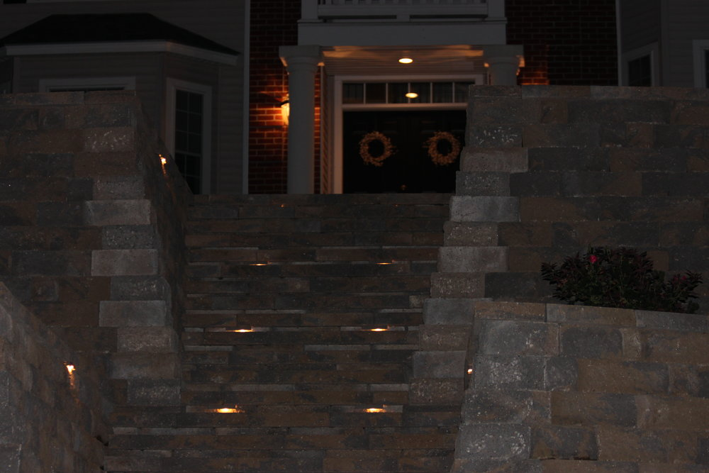 Beautiful landscape design with an outdoor lighting area in Hollis, NH