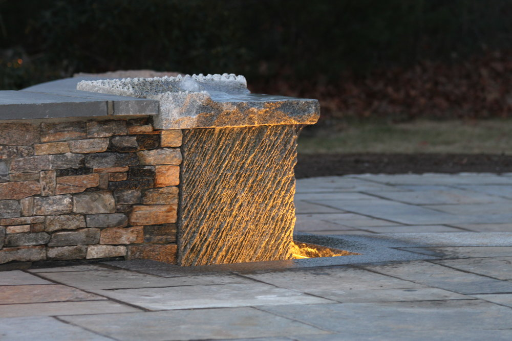 Professional landscape design with stone veneer in Laconia, NH