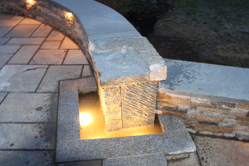 Top landscape design with stone veneer in Laconia, NH