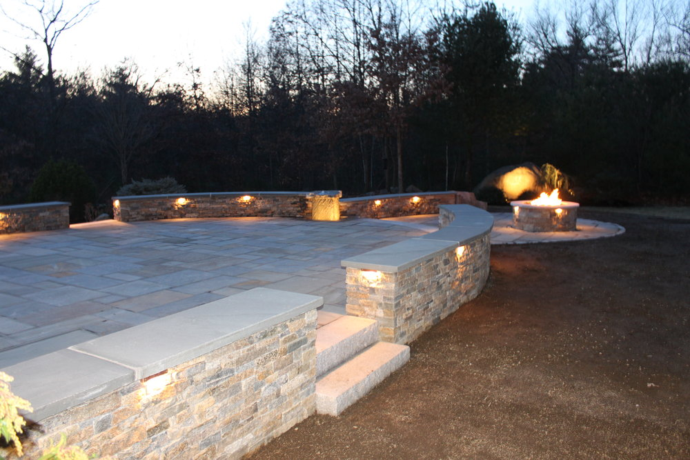 Professional landscape design with fire pit in Laconia, NH