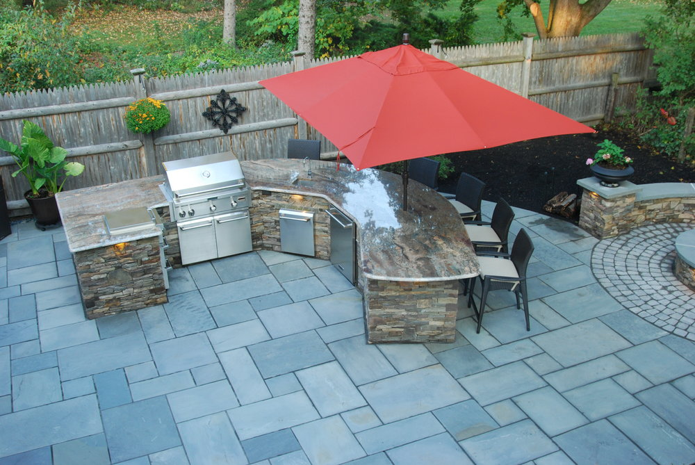 Top landscape design with an outdoor kitchen Westford, MA