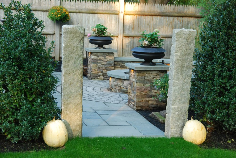 Landscaper in Waltham, MA with landscape design and masonry services, including paver walkway installation.