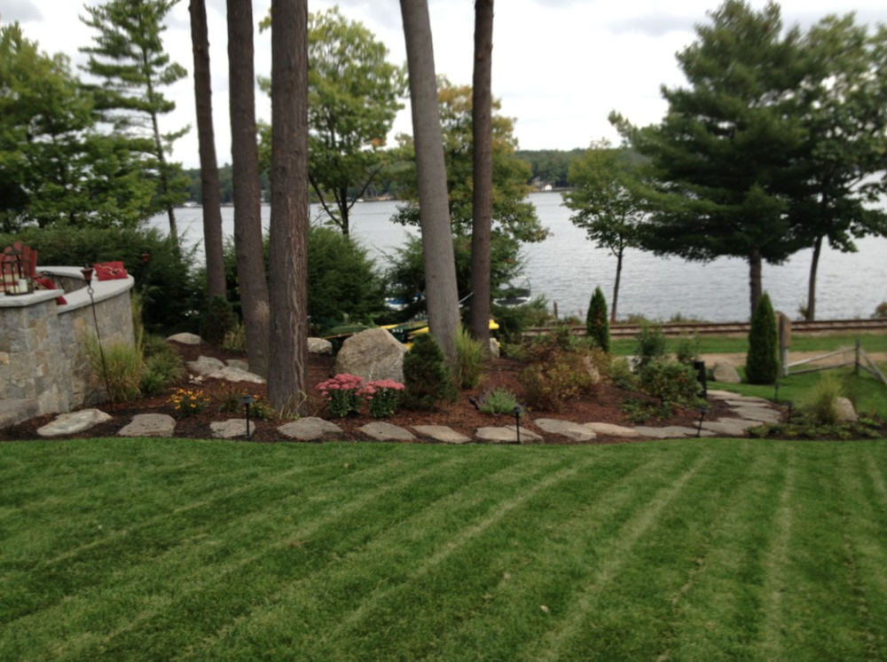 Landscape design with a fire pit | Laconia, NH
