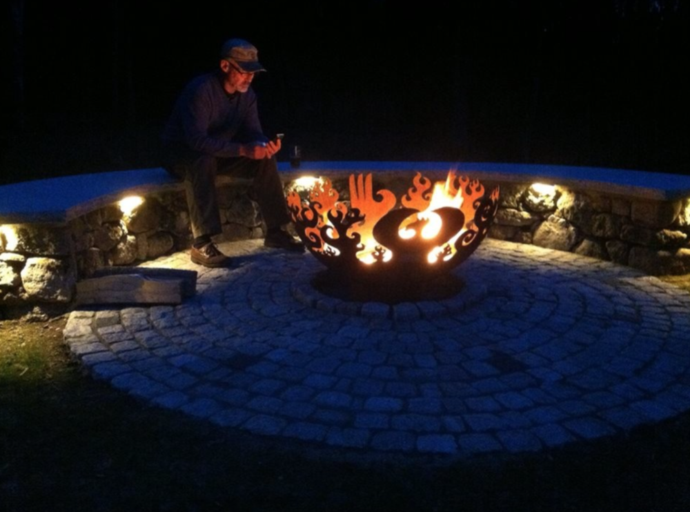 Landscaer in Laconia, NH with top outdoor fireplace