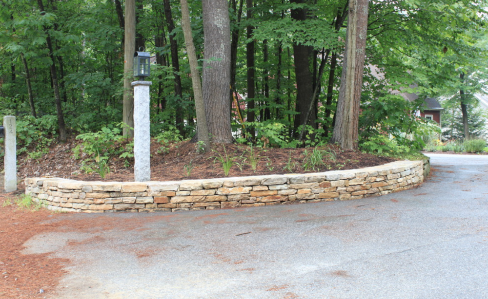 Landscape design in Hollis, NH with top masonry work