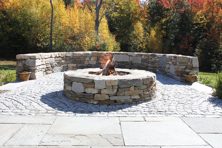 Top landscape design of an outdoor masonry fireplace in Hollis, NH, by Unilock authorized landscaper