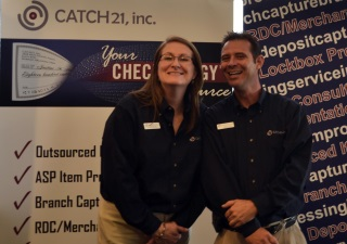 Kaye Taupmann , Client Relations Executive and  Richard Owens , Sales Executive manning the Catch21 booth.