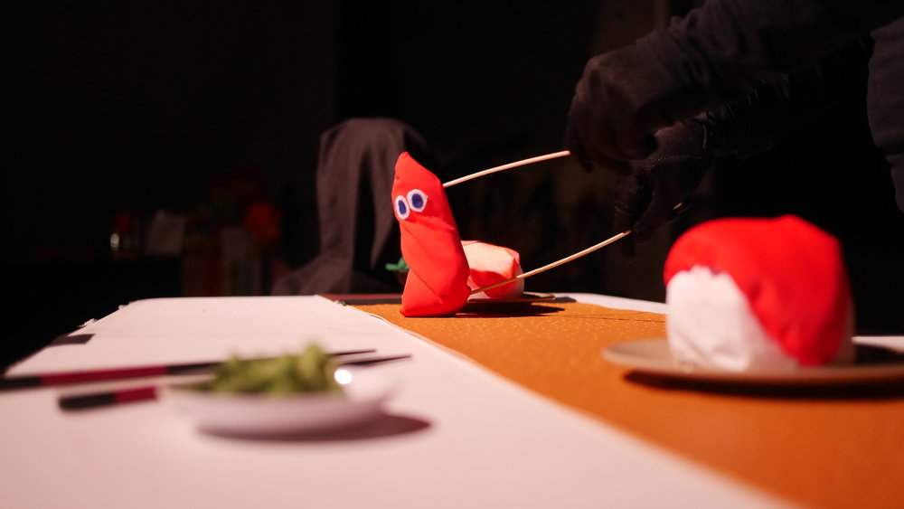 """""""Sushi"""" - A startled piece of fish tries to escape its destiny, in this table top puppetry short."""