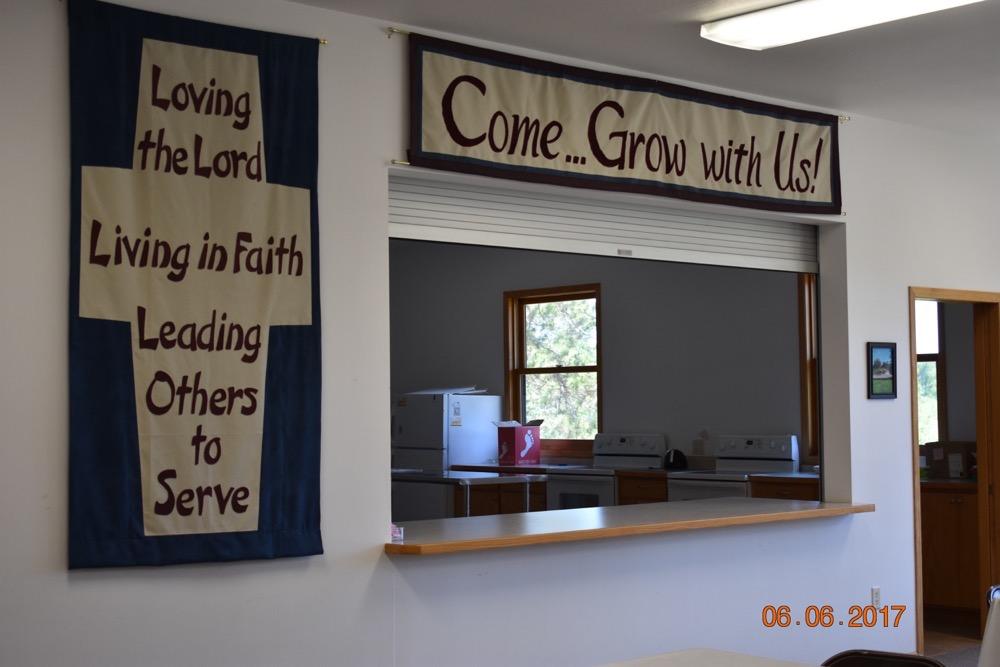 st john mission banner and kitchen window.JPG