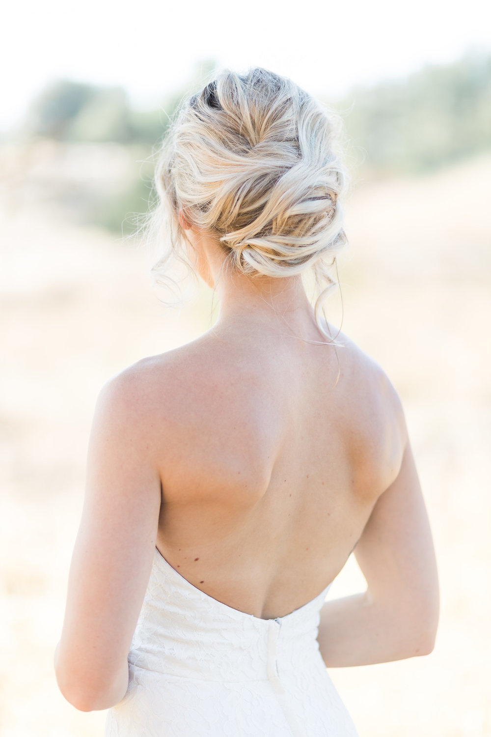 Gorgeous loose and boho updo for a Los Angeles bride