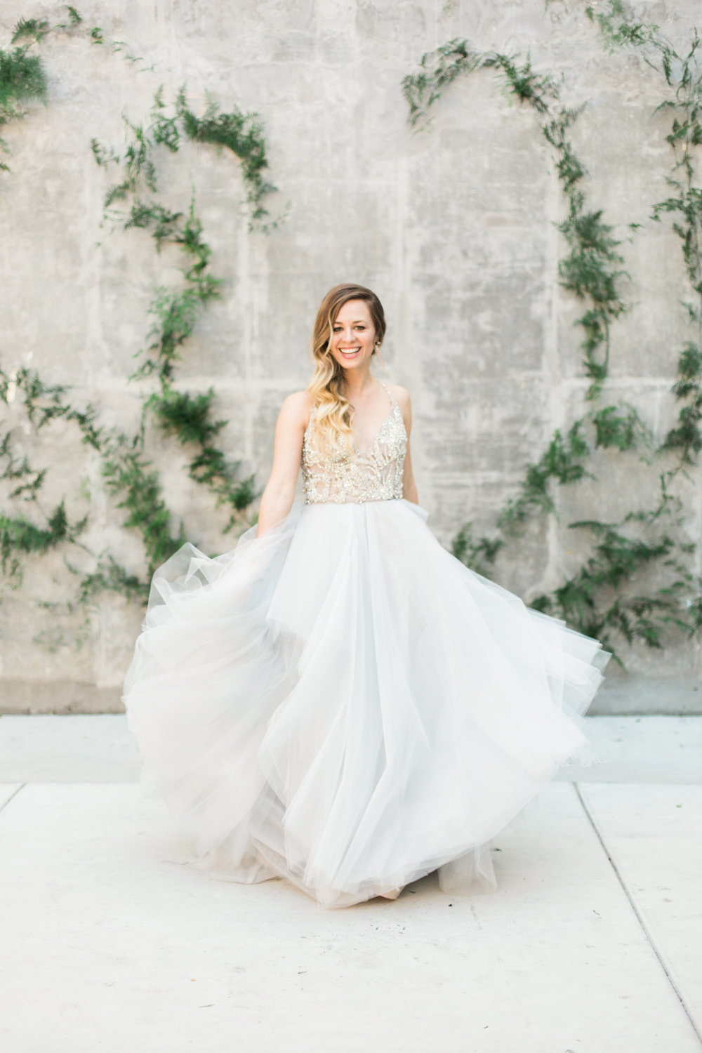 Bride twirling in her Hayley Paige gown in Long Beach, CA