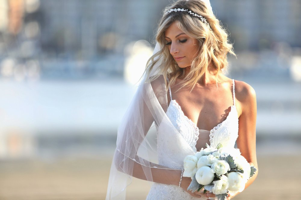 Sunkissed and bronzed bride at sunset