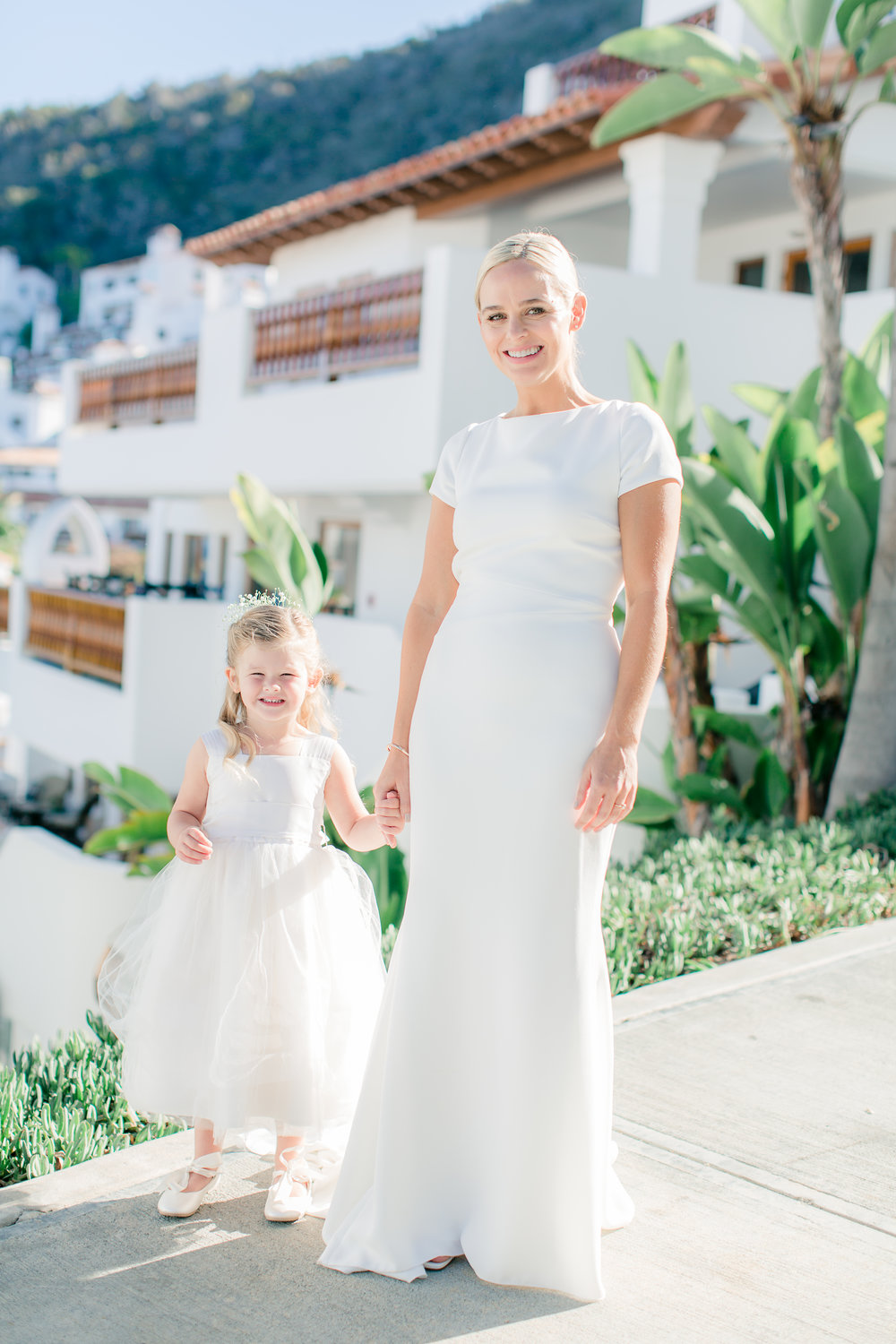Bride and flower girl in white