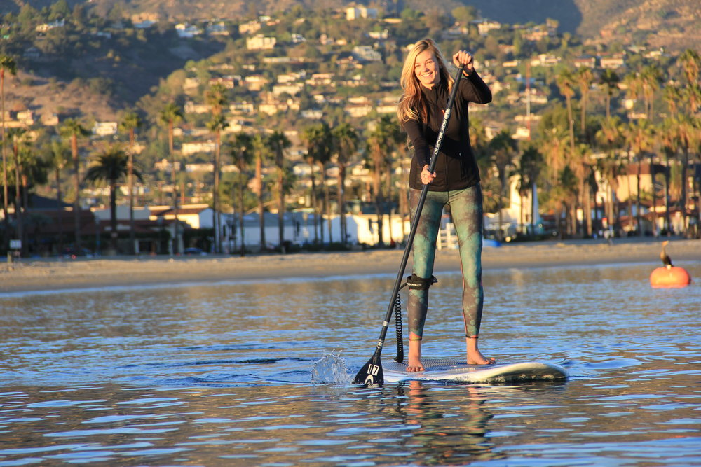 Beautiful woman Stand-up paddle boarding in santa barbara