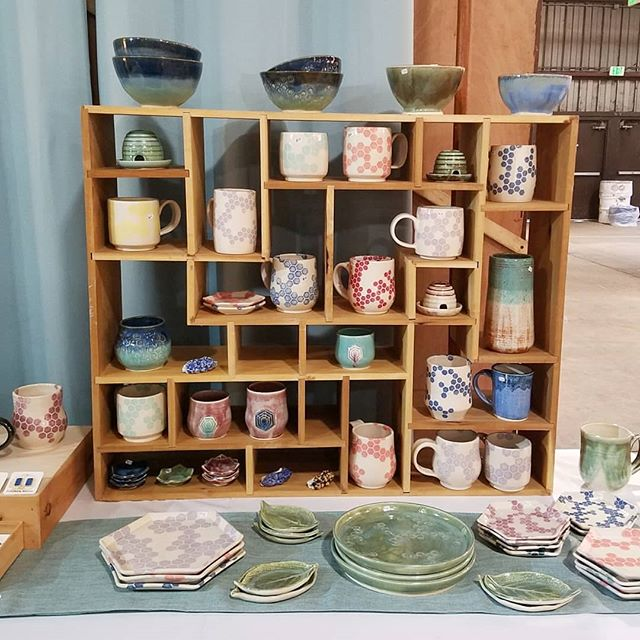 We are open! Last day of #sugarloafcrafts. We will be here until 5pm so stop by and see me in booth 182. . . . . . #craftshowdisplay #craftshowbooth #pottery #ceramics #functionalpottery #shophandmade #makersmovement #localart #shoplocal #beekeeper #honeybee #honeycomb #geometric #hexagon #miffyyost #foxglovestudio #foxglovestudiopottery