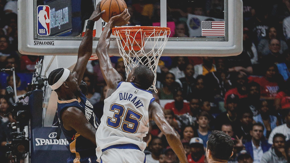 Kevin Durant with 1 of his career high 7 blocks against the Pelicans Friday night.
