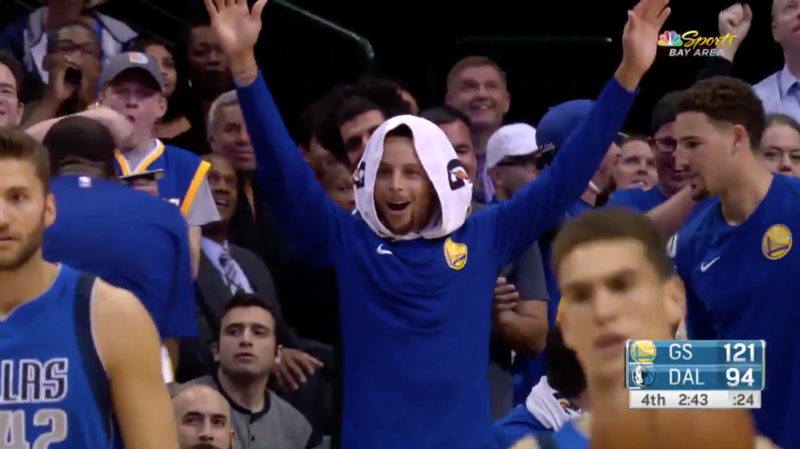 Steph Curry celebrates Jordan Bell's slam late in the game against the Mavericks