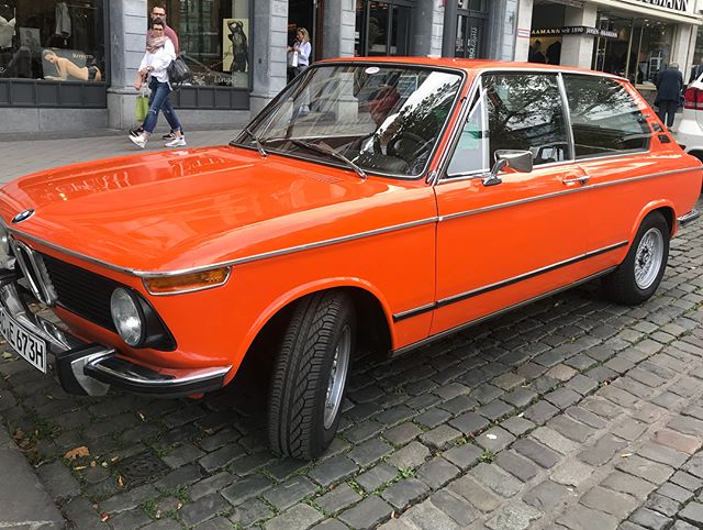 Out for a stroll when this beauty pulled up! #bmw2002touring . . #sexylittlecars #driveme @sundaydriversnygt #notmycar #parkedinaachen