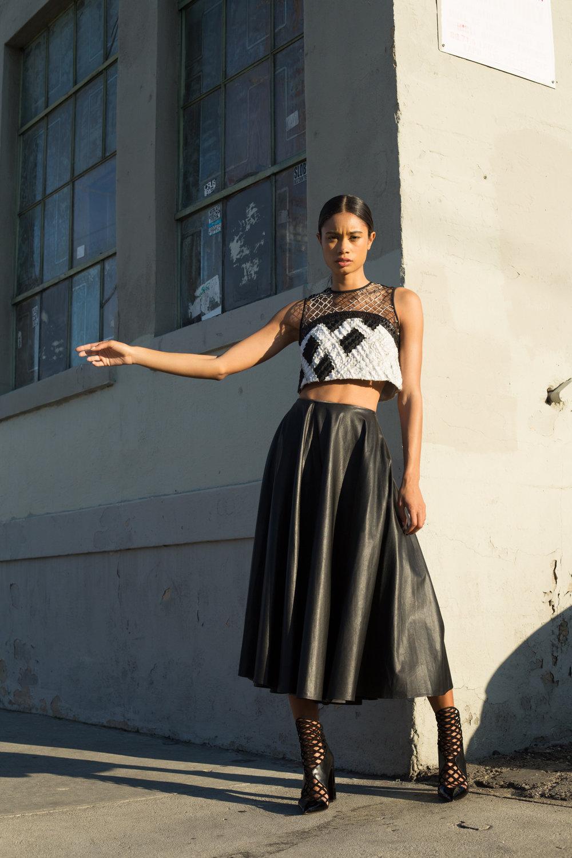 Jonathan Simkhai mesh crop top, BreeLayne leather skirt,Christian Louboutinboots