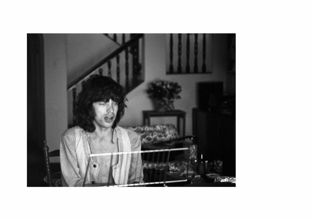 """Mick Jagger – 'Faraway Eyes'Malibu, California 1976 """"Mick often sat up late composing and playing with Ronnie Wood when he came to stay in Malibu. I love this picture because he was writing the song 'Faraway Eyes', at the time, and it was such a gentle love song. He gave it a Country and Western twist because he loved the Willie Nelson song 'Blue Eyes Crying in the Rain'. I am not sure whether it was deliberate on my part to 'soft-focus' the image, but it suits the mood of the song..."""" Carinthia West"""
