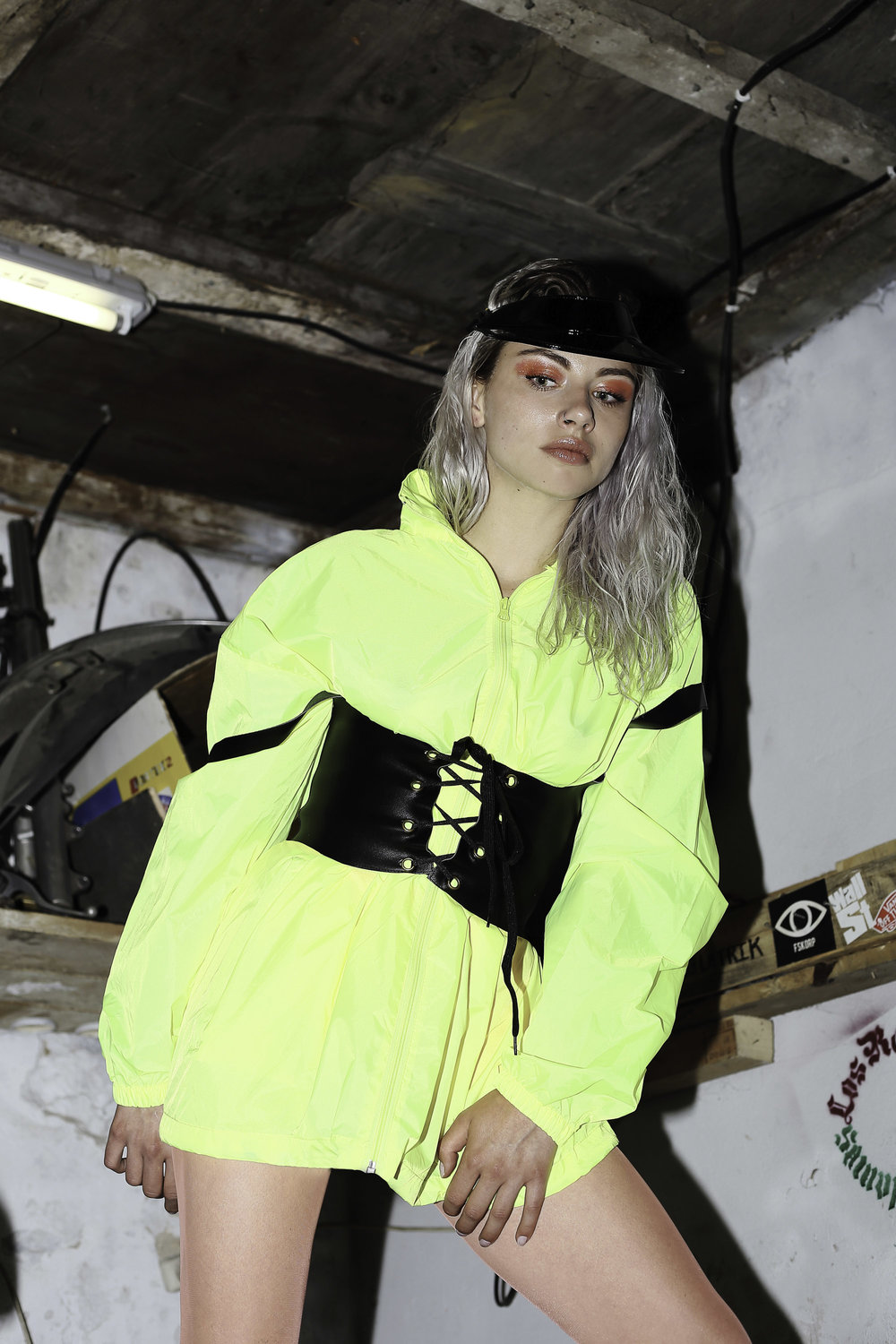 Reclaimed Vintage Inspired trench, Stylist's own corset, Falke tights, Christian Lacroix visor