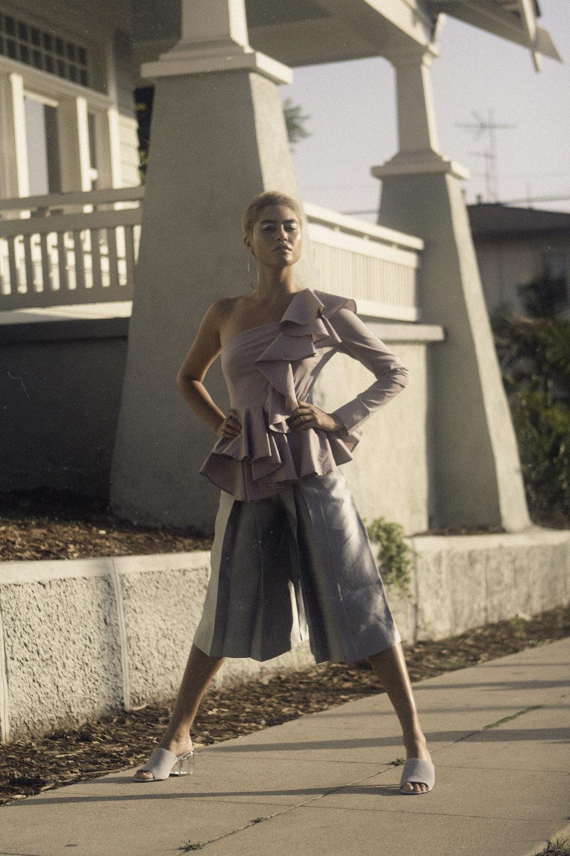 Blouse—LEITH Pants—ZIZTAR Shoes—STEVE MADDEN Earring—STYLISTS' OWN