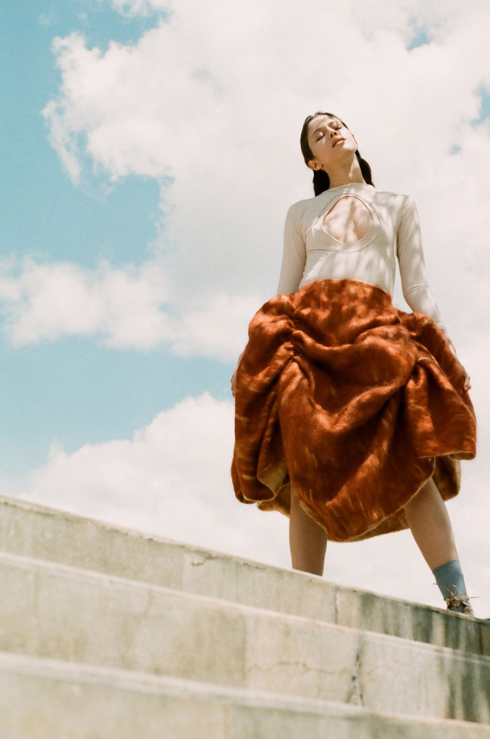 Skirt  —ANA ISABEL TABOADA Bodysuit  —CAMILA TIRADO
