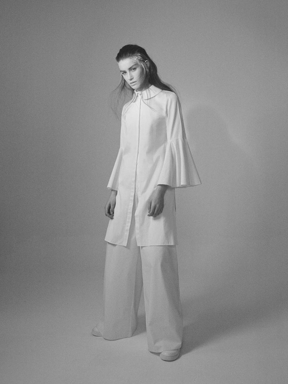 Optic white cotton shirt dress with satin stripes from Alistar James White cotton trousers with straight leg from Xiao Li White sneakers from Fengchen Wang