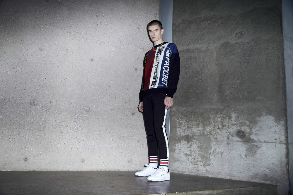 Sweater by Gosha Rubchinskiy, Black pants with white stripe by Off-White