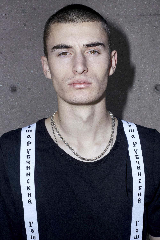 Black T-shirt by Skim Milk, Suspenders by Gosha Rubchinskiy
