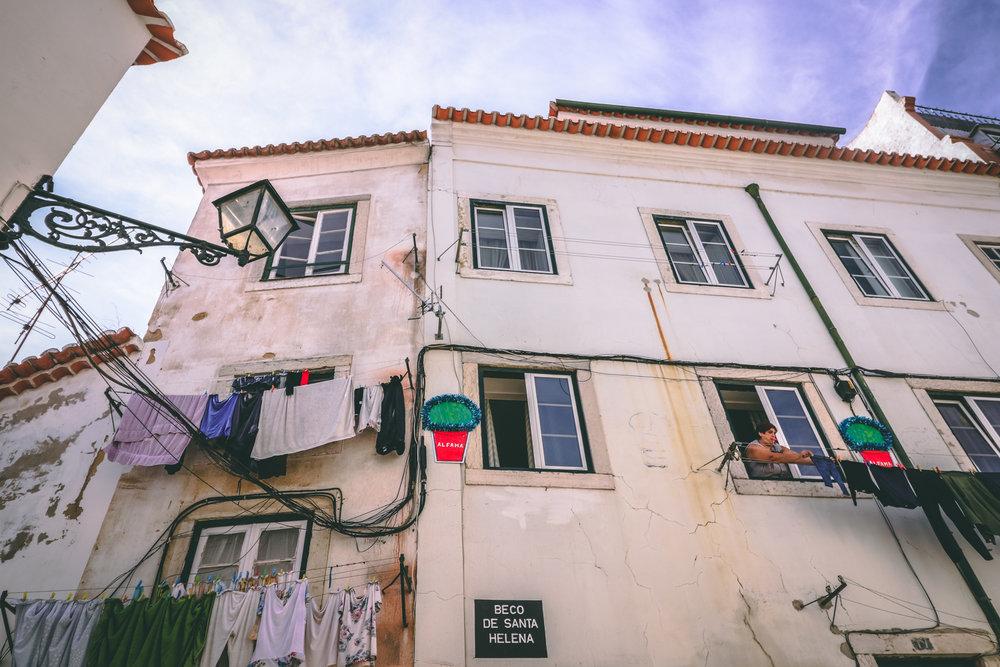 Jason Hendardy Lisbon Alfama Lady Hanging Clothes.jpg