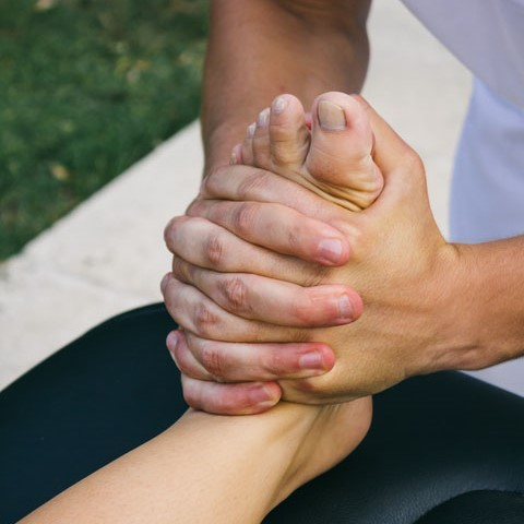 professional helping with foot mobilisation and manipulation