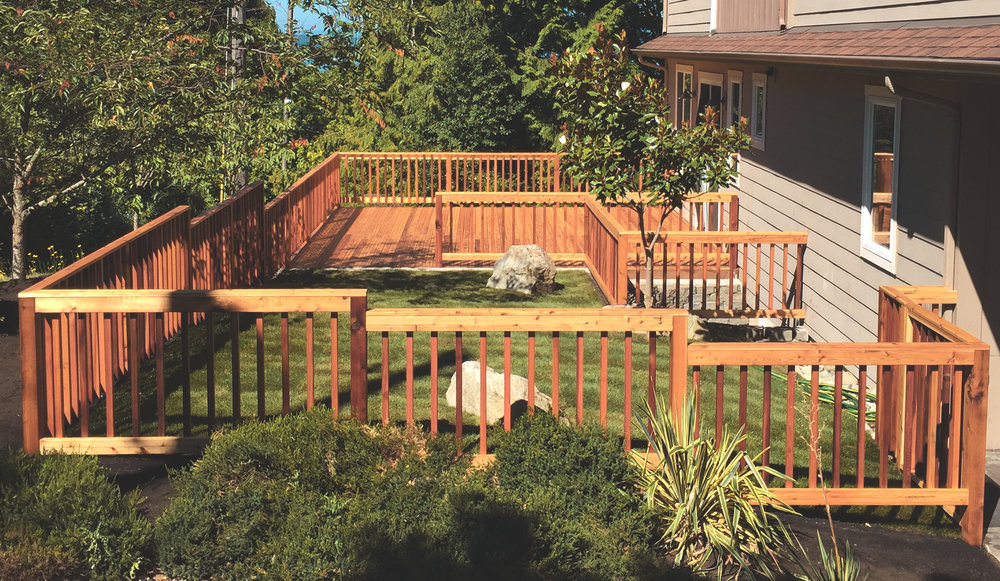 "Inset deck with fence/railing combo  (Deck composed of 4"" decking. Built with all tight knot cedar lumber.)"