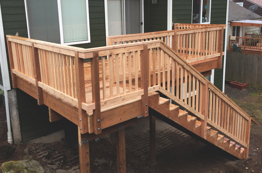 "Second level craftsmen deck  (Deck composed of 6"" decking. Built with all tight knot cedar lumber.)"