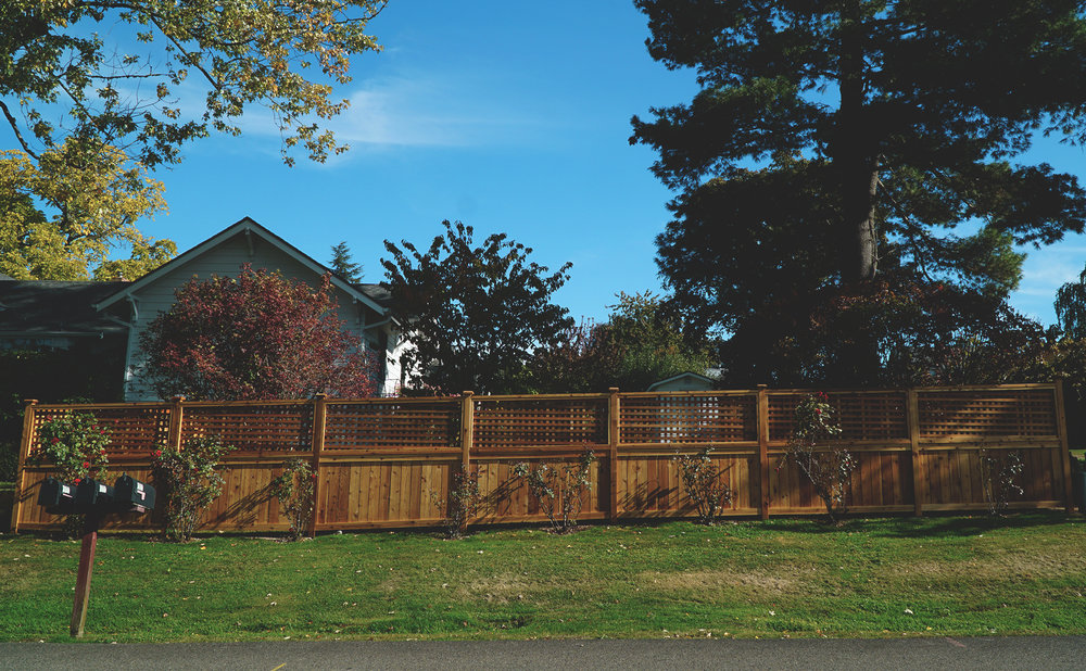 "Square Lattice Fence  (Fence composed of 6"" rough cut fence boards and lattice made with locally sourced lattice panels. Built with all tight knot cedar lumber.)"