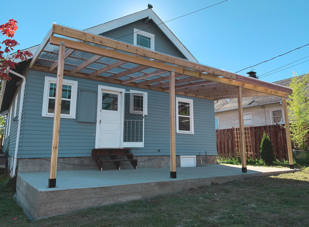 Patio Cover  (Built with smooth cedar lumber and Suntuf roof panels)