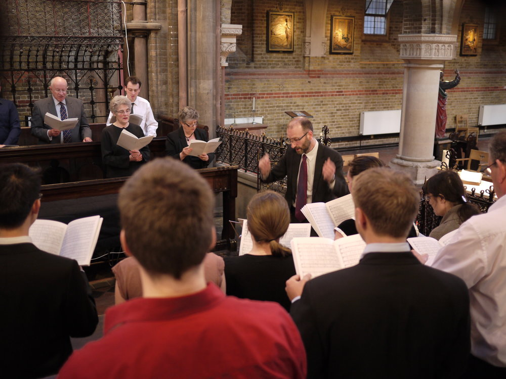 The St Peter's Singers rehearse for a choral service.