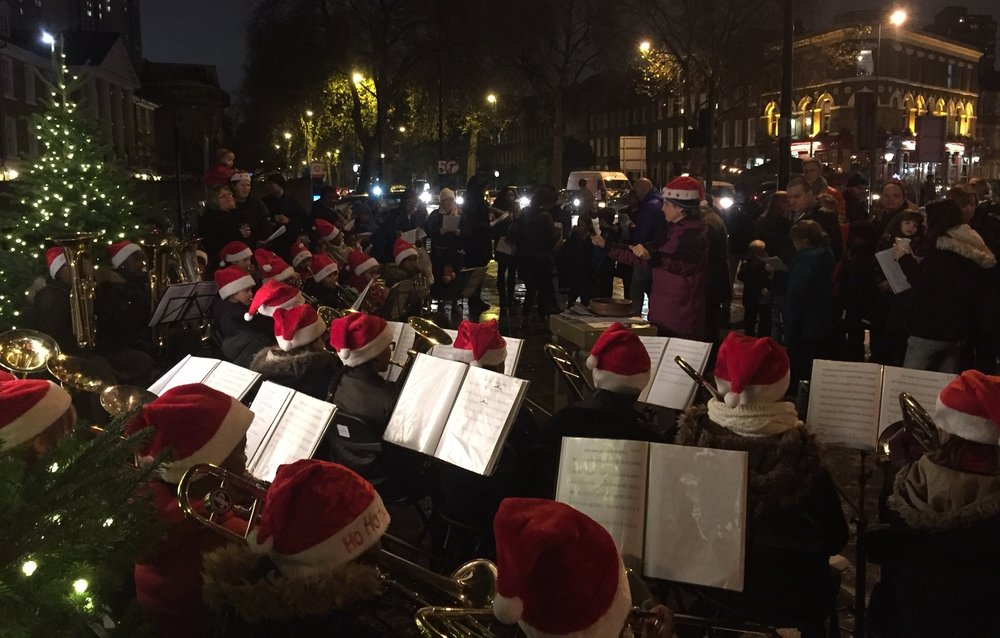 Archbishop Sumner Primary School brass band playing carols outside St Anselm's in 2016