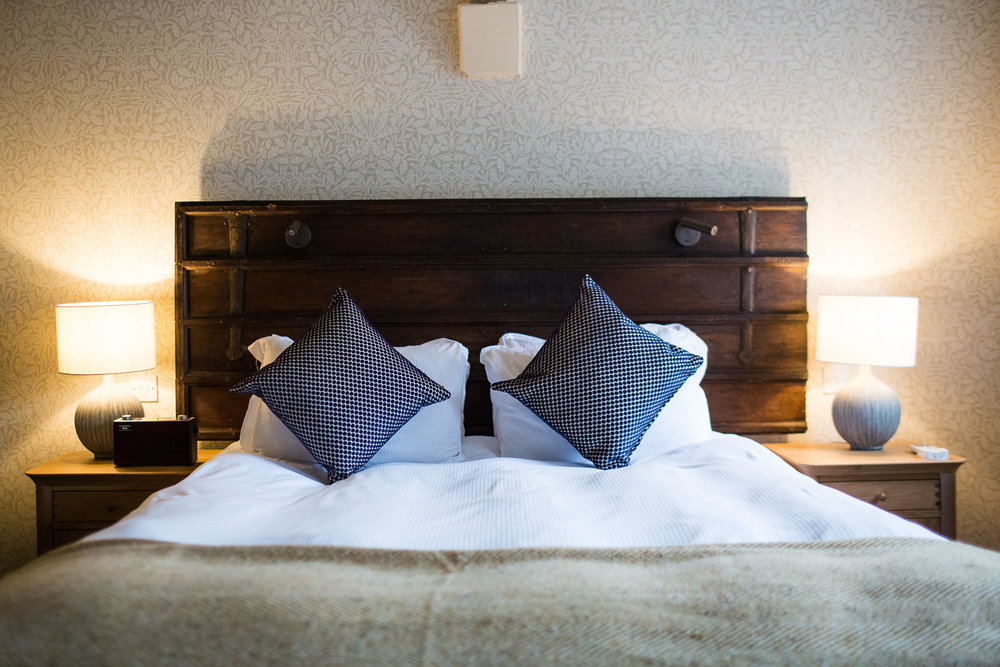 Bed and headboard at The Blue Boar pub, restaurant and hotel in Witney, Oxfordshire.jpg