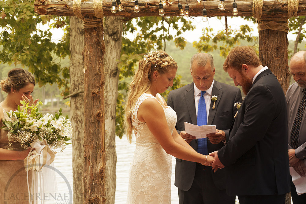 Lindsay's father stepped inwhile the couple performed a knot tying ceremony.
