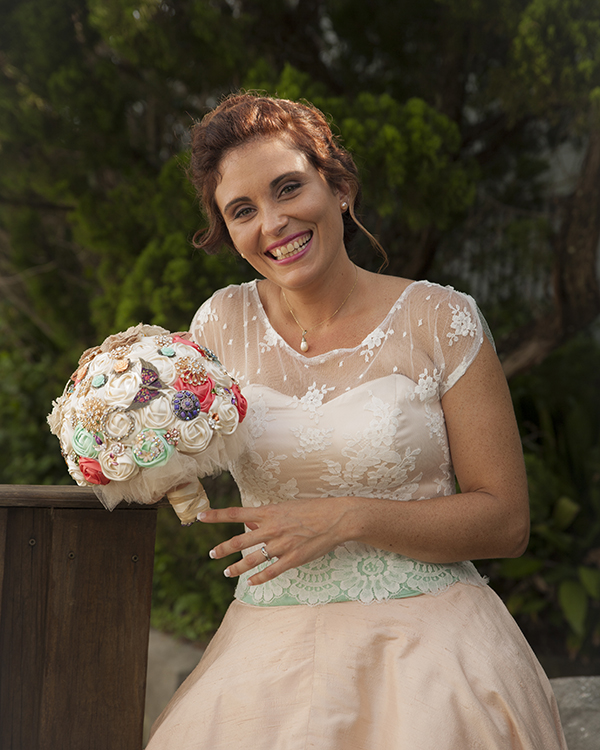 Laughing Bride with brooch bouquet